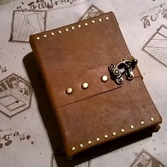 Latest little studded leather creation. #notebook #journal #bookbinding #handmade #handmadebook #bookart #vintage #boundbook by stampystamps