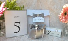 Rhinestone and Pearl invitations, table numbers, escort cards and favors. See more custom-made invitations & favors at wrappedupindetails.com