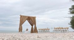 Burlap sashes on the chairs match the draping on the arch