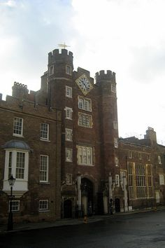 St. James's Palace, was commissioned by Henry VIII, on the site of a former leper hospital (disbanded in 1532) dedicated to St James the Less (from whom the Palace takes its name). The new palace was  constructed in the red-brick Tudor style around four courtyards. It  became the principal residence of the monarch in London from 1698,  when Whitehall Palace was destroyed by fire, and became the  administrative centre of the monarchy.