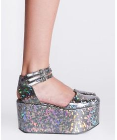 OMG - I used to have a pair of silver glitter 6 inches sandals so much like these when I was 22 or 23 - I am 60 now but still love those shoes...