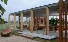 Estufa de Ivan Rezende. Destaques: o ecotelhado onde crescem plantas e o revestimento do teto e do chão, um composto reciclado de madeira e cimento (Foto: Kitty Paranaguá / Divulgação)