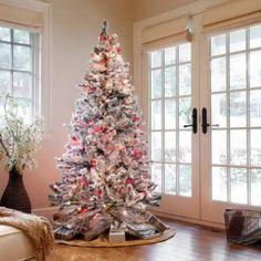 White Christmas tree. It's always a great idea to go with the classic white Christmas theme this season.
