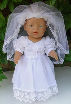 This gorgeous set includes a stunning white dress with lace and flower features on the bodice and lace around the hemline.  The dress fastens at the back with a Velcro strip and has a large bow decoration.  Also included is a petticoat, a veil with floral embellishments on the headband and a pair of white cotton underpants.   Dolly can wear the gown without the veil for a Christening gown or with the veil when she is the bride.