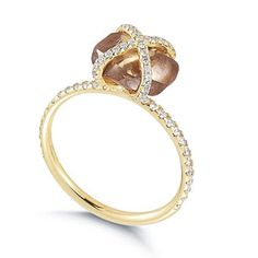 18k yellow gold Embrace ring with with micropavé diamond accents and rough-cut diamond center stone, about $8,000, Diamond in the Rough