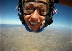 Kathryn Budig getting goofy up in the air...who else wants to skydive?!