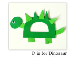 This dinosaur was great for identifying several different shapes with the kids ~ triangles, rectangles, and ovals. When we sat down to put the craft togeth