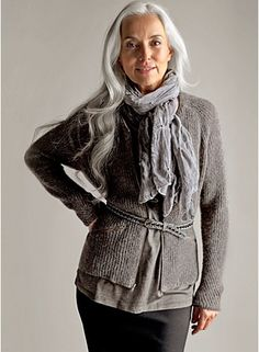 This woman is beautiful.  Love that she wears her gray hair long~ love the outfit too