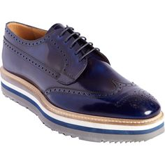 http://www.lyst.com/shoes/prada-stacked-sole-perforated-wingtip-blucher-navy/?product-gallery=8936282