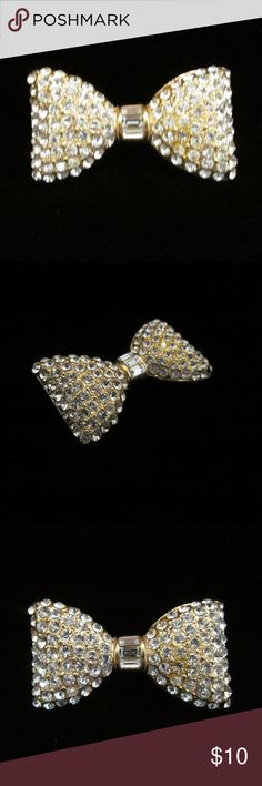 "Vintage Rhinestone Bowtie Brooch Pin Gorgeous Vintage Goldtone Metal Bow Tie Sparkling Rhinestone Brooch Pin  Measures approx. 1.75""  Condition: Good. Back stickpin is a little bent.  ********** Vintage Jewelry Brooches"