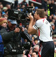 "Manchester United 0 v Liverpool 3 via The Guardian, the journalist reporting on the match wrote:"" Steve Gerrard's celebration is that ""kissing the camera"" thing he's rather fond of. The cameraman certainly doesn't seem to mind, however, even if it does mean he'll have to clean the lens now."" LOL"