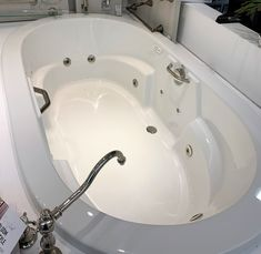 The Brisa tub displayed at Ferguson in Mineola, NY Drop In Tub, Ferguson Showroom, Kitchen And Bath, Bathtub, Home Appliances, Display, Standing Bath, House Appliances, Floor Space