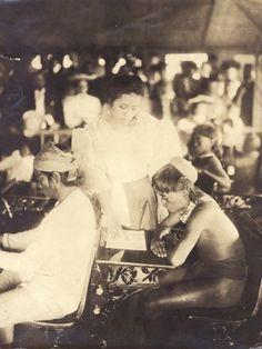 """Miss Zamora, the native Filipino teacher instructing an Igorrote pupil in reading."" (1904 World's Fair, Philippine Reservation). Missouri History Museum"
