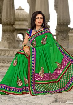 Parrot green faux chiffon resham, zari, sequins, stone, bead embroidered and patch bordered saree. As shown contrasting blue art silk blouse can be made available and also can be customized as per your style or pattern subject to fabric limitation. (Slight variation in color embroidered and patch border is possible. ) data-pin-do=