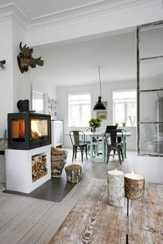Great idea for the woodstove and to add storage below! Totally going to see if we can do this! Danish Home Interior Design