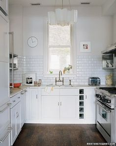 To achieve a feeling of openness, Suzanna washed the kitchen in a clean, pale palette.