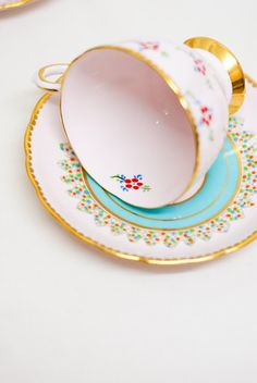 Baby pink duo - Mismatched Hand Painted vintage Tuscan English bone china Duo Tea Set, lovely flowers, gilded and blue shapes c. 1940.