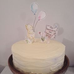 Winnie the Pooh 1st birthday cake, honey banana flavour with hand painted watercolour cake toppers in card.