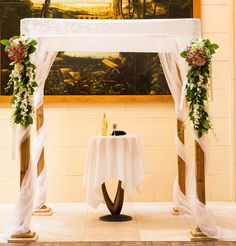 The Cedar Chuppah with Organza Drapes and Satin Top at the Windsor Arms Hotel
