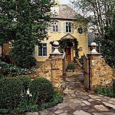 French cottage by M. Classic French country cottage, beautiful stone entry gate-make it mini ( like knee high)