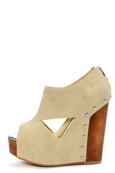Chinese Laundry Jam Session Stone Cutout Platform Wedges! Burnished beige faux leather shooties are low cut at the ankle, with angular cutouts along the sides, plus a peep toe below, where the silver metallic insole offers up a subtle pop of shine. 2