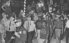 Protesters on Milwaukee's south side taunt NAACP Youth Council marchers in this file photo. The youth council and its adviser, Father James E. Groppi, held marches from the north side to the south side's Kosciuszko Park via the 16th St. Viaduct on Aug. 28 and 29, 1967; both demonstrations were met by thousands of protesters.