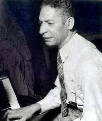 "Jelly Roll Morton, was an American ragtime and early jazz pianist, bandleader and composer.  Widely recognized as a pivotal figure in early jazz, Morton is perhaps most notable as jazz's first arranger, proving that a genre rooted in improvisation could retain its essential spirit and characteristics when notated. His composition ""Jelly Roll Blues"" was the first published jazz composition, in 1915."