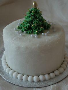 Mini christmas cake with christmas tree and sparkle