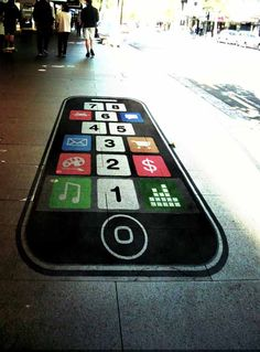 Are iPhone gaming apps replacing traditional, real world games (like hopscotch)?  That is the question proposed by this humorous, mobile technology themed guerrilla street art.