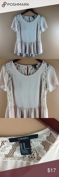 F21 Blush Lace Top Flowy blush lace top in size medium from Forever 21.  Great condition.  🌵 Add to a bundle for an automatic discount or make an offer.  💕 If you bundle tour likes together I can send you a private discounted offer, just let me know! Forever 21 Tops Blouses