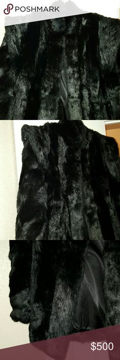 Amazing Fur Coat Rabbit Fur coat with vintage style shoulders makes this coat fabulous! Step out in style this winter! Coat is in great condition!!!!! You will love it! Jackets & Coats
