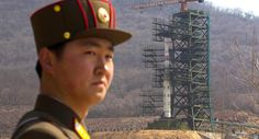 A North Korean soldier is pictured in front of the country's Unha-3 rocket. | AP Photos