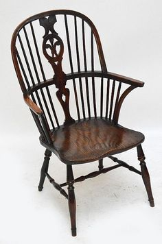 An Early 19th Century Yew Wood And Elm Hoop Back Windsor Chair With Prince  Of Wales