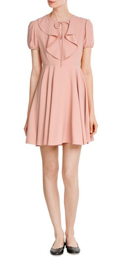 In blushing pink crepe with a pretty bow at the neck, this lightweight style from RED Valentino is a girlish choice with romantic charm. The flared skirt is flattering and promises to move gracefully as you walk, while the bib-detailed front is super pretty #Stylebop