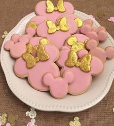 Pink and gold Minnie Mouse birthday sugar cookies. Edible glitter.