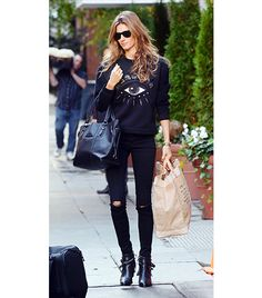 Gisele Bundchen    You can always play up the fashion sweatshirt's cool-girl vibe like Gisele Bundchen—photographed here wearing the next generation of Kenzo's cult favorite sweatshirt, the Eye Embroidered Sweatshirt by simply teaming it with distressed denim and leather ankle boots.