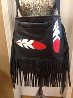 TWO FEATHER BAG. Max-Wear is a unique Aboriginal clothing/apparel business. We are made up of a family of artists whom work together to collaborate and share our ideas to give you the very best of our clothing designs and textile art murals; which we design with different animal or aboriginal themes. We appreciate the wilderness and all wildlife, so we love to capture their essence in our apparel and art...we want to show our appreciation of this beautiful country we live in...