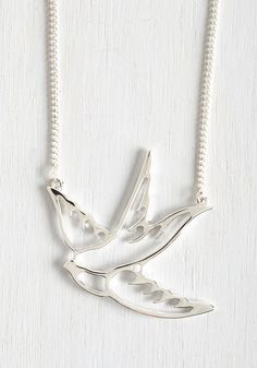 Swooping Swallow Necklace. There's nothing quite like a tattoo reference to add a hip edge to any outfit. #silver #modcloth