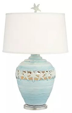 Coastal charm comes home in the Pacific Coast Lighting Starfish Table Lamp . This whimsical table lamp features an organic shaped base with cut-out starfish. Beach Cottage Style, Coastal Cottage, Coastal Homes, Beach House Decor, Coastal Style, Coastal Decor, Coastal Farmhouse, Coastal Lighting, Beach Lighting