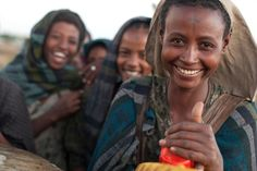 Women laugh at their village's freshwater well in Donzoye Kurabas, Ethiopia.