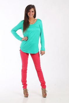 """The Ana Top, Jade $36.00  Every wardrobe should have this top! The soft jade piece has a simple silhouette and scoop neck, and the back has criss-cross strands of fabric for a lovely added detail! Throw this piece on with colored skinnies or shorts for a fun look!   Fits true to size. Miranda is wearing a small.   From shoulder to hem:  Small - 26""""  Medium - 27""""  Large - 28"""""""