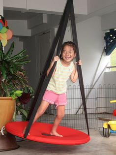 3. Though it's been discontinued, Ikea's Svava swing offers inspiration for DYIers. A hula hoop and some kite fabric will get you started. And let's face it, will be easier to replace if the dog mistakes it for a frisbee. (photo credit: wee-stories.com)