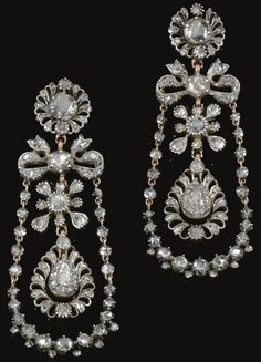 Pair of diamond pendant earrings, circa 1800. Each of stylised foliate and ribbon design, suspending a chain of rose diamonds in cut down collets and closed back settings, embellished with a swing set to the centre with a pear-shaped rose stone within surrounds of rose diamonds.