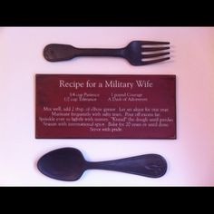Recipe for a military wife, love it with the oversized fork and spoon next to the sign!