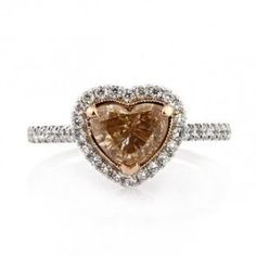 Brown Heart Shape Diamond Engagement Ring - A gorgeous Brown Heart Shape Diamond Engagement Ring featuring a 1.03 carat Brown Heart Shaped gemstone in a designer setting. This GIA certified ring has halo style White Round Brilliant cut accent stones around the center stone. The stone is Fancy Brown in color, the accent stones in white, SI2 in clarity & stamped in a 18k White Gold. The total gem weight of the ring is 1.73 carats & all of the diamonds are 100% natural. #unusualengagementrings