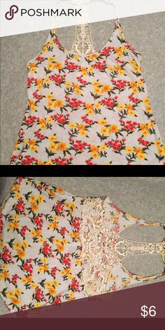 Floral tank with back detail This loose fitting floral tank top has cream lace detail on the straps and in the t-back. Never worn before and in great condition. Would work as a small, medium, or large. Very soft fabric. Price can be discussed. Full Tilt Tops Tank Tops