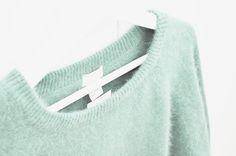 Mint green fuzzy sweater.