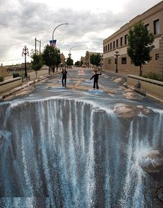 Sidewalk Art! I would honestly be afraid of walking in it, it looks like the edge of the earth lol