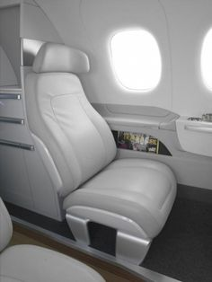 BMW DesignworksUSA have teamed up with Brazilian aircraft manufacturer, Embraer, to present a new generation of the company's executive jets.  This interior is intended for the company's line of medium-range jets. Featured on the Phenom 100 and 300, the cabin blends modern styling with futuristic design.  It features a full galley and lavatory and a very Teutonic, tech-heavy lounge-style cabin with lay-flat seats, deployable tables, and muted lighting.