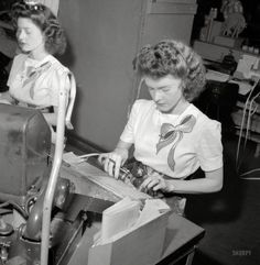 """June 1943. """"Washington, D.C. Pasting up a telegram at the Western Union telegraph office. Doris and Dorothy Bell send and receive telegrams from the Baltimore circuit."""" Photo by Esther Bubley for the Office of War Information."""